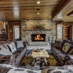 Log Cabin Fireplace with Natural Stone