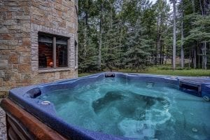 Outdoor Spa with Castle Rock Natural Stone Wall