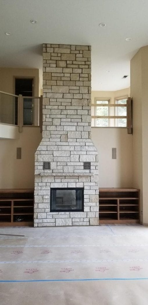 Custom Coastal Mist Fireplace with colored stone removed