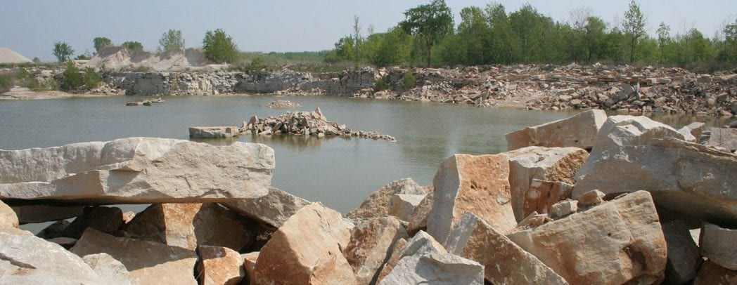 Quarry in spring fills with water becoming a resting place for migrating birds