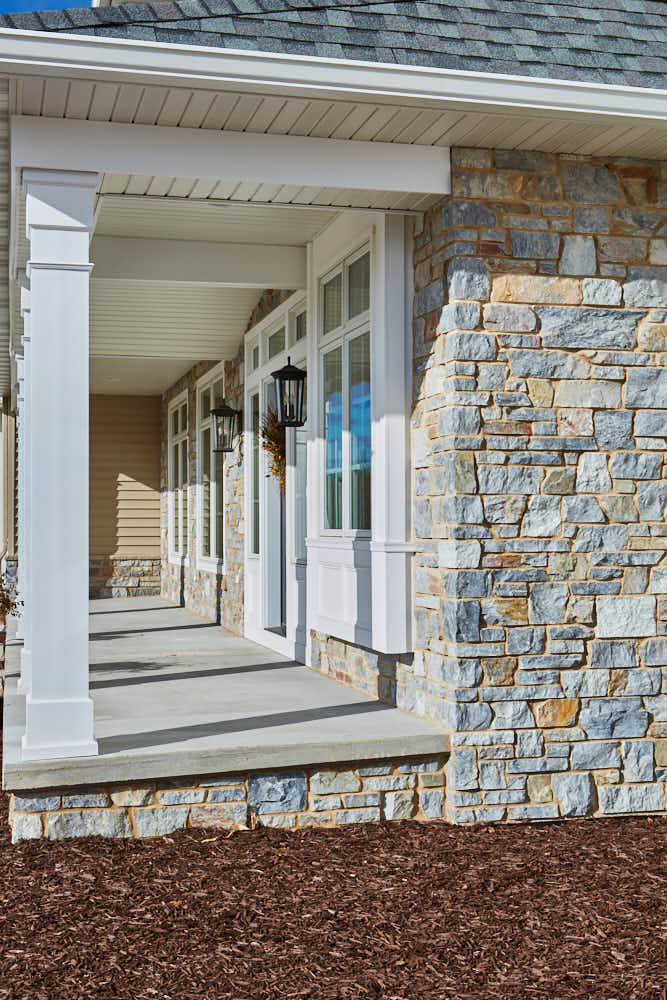Chamberlain Natural Stone Veneer Exterior with Tan Mortar