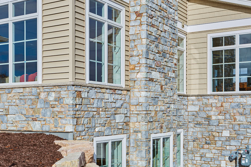 Chamberlain Real Thin Stone Veneer Exterior with Tan Mortar