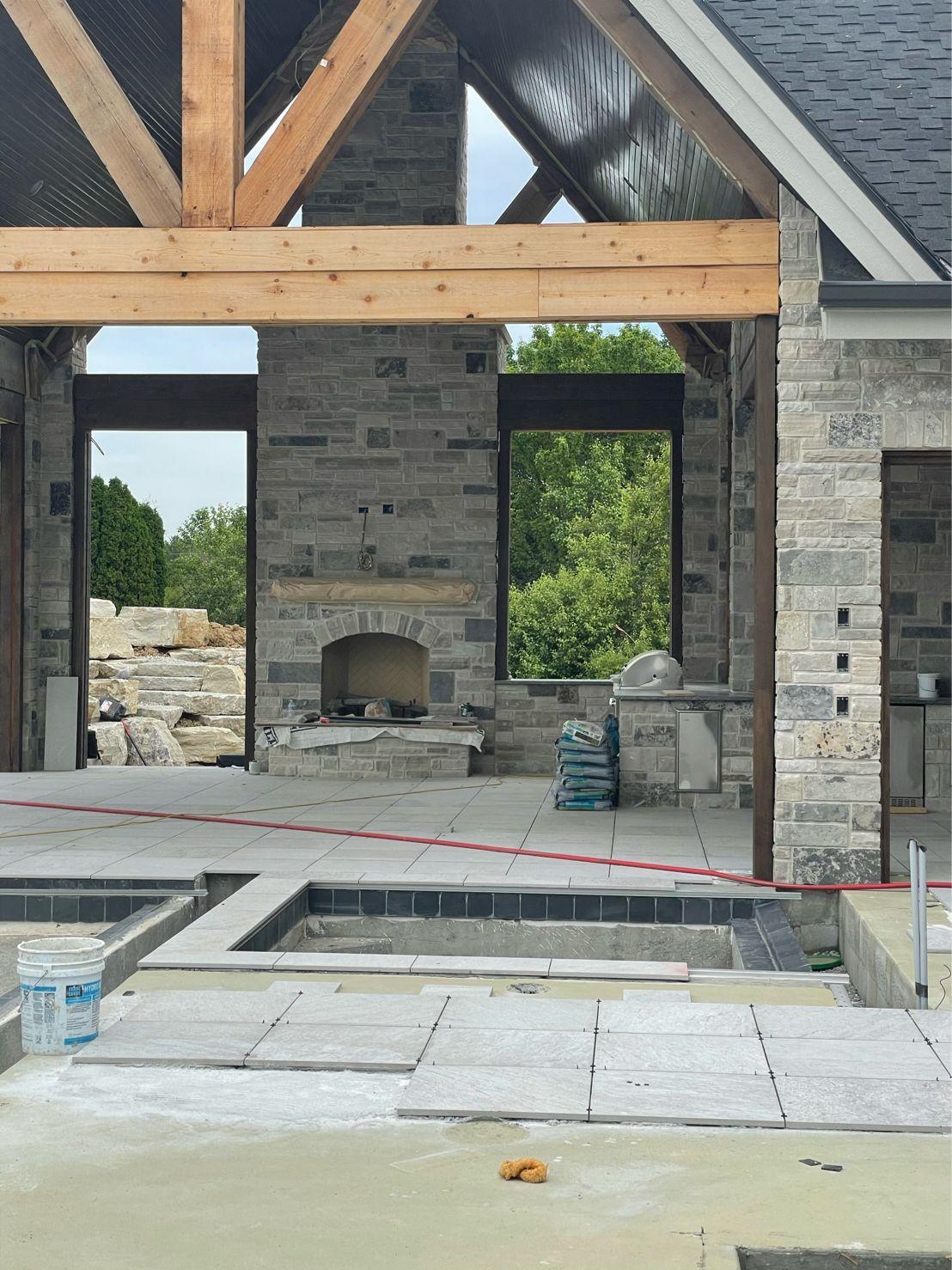 Graphite Ashlar Natural Stone Veneer Covered Patio