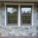 Bayside with Augusta Real Thin Stone Veneer Covered Patio