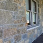 Castle Ridge and Baltic Hills Natural Stone Veneer Blend Covered Front Porch