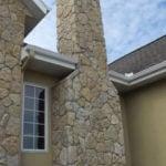 Custom Mosaic Tumbled Castle Ridge Real Stone Veneer Chimney